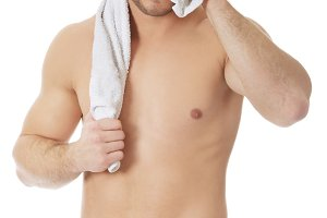Young athletic man with a towel.