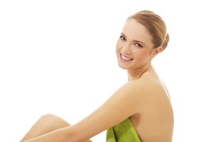 Beautiful spa woman sitting with a towel.