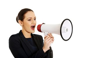 Businesswoman with a megaphone.