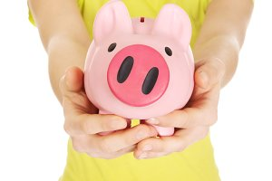 Unhappy woman holding piggybank.