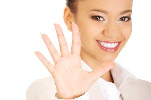 Businesswoman gesturing five in hand.