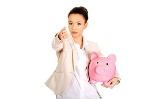 Businesswoman with piggybank and thumbs down.
