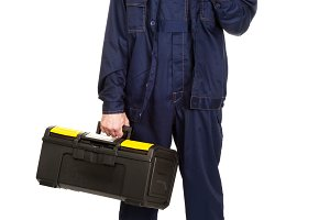 Mature worker with tools bag and wrench