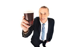 Smiling businessman with a cup of coffee