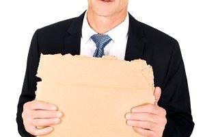 Businessman holding a piece of cardboard