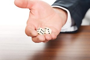 Male hand with two dices