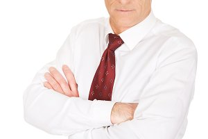 Serious mature businessman with folded arms