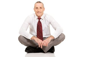 Businessman sitting cross-legged on the floor