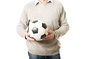 Mature man with a soccer ball