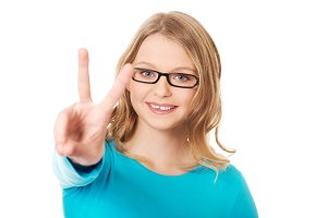 Happy teenager showing victory sign