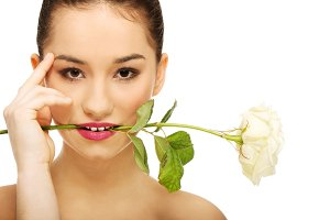 Woman with white rose in mouth.