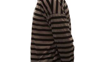 Caucasian man prisoner in striped clothes