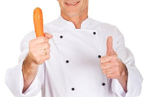Male chef with a carrot showing ok sign