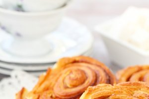 Baked sweet cinnamon rolls with cup of tea