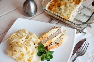 Slices of baked turkey breast fillet with fettuchini