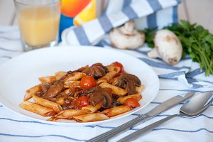 Penne pasta with tomato sauce and mushrooms