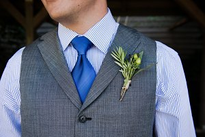 Wedding boutonniere pinned on groom