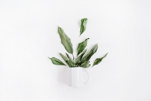 Mug with green leaves