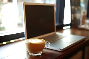 laptop with fresh cup of coffee