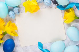 Easter frame with painted eggs and flowers