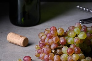Fresh grapes with wine bottle