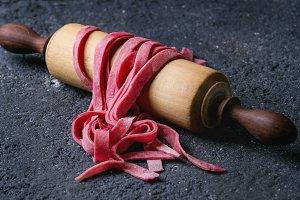 Fresh homemade pink pasta tagliatelle