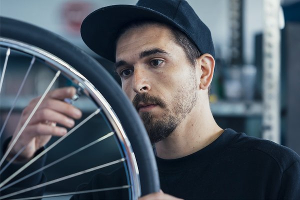 Industrial Stock Photos: Click and Photo - Craftsman works in a bike workshop