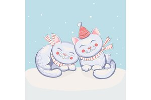 happy cute kittens sits on the snow