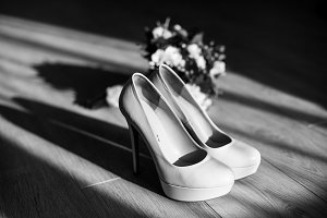 The wedding shoes and bouquet