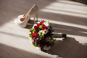 The wedding bouquet with shoes