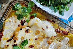 Baked hake with garlic and potatoes
