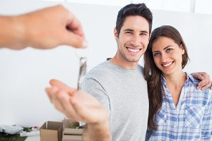 Happy man being given a house key