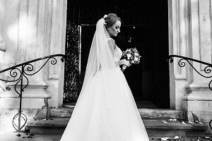 The charming bride on the stairs