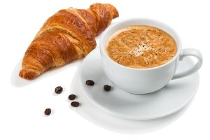 Breakfast with coffee and croissant.