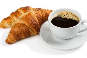 Delicious coffee with croissants.