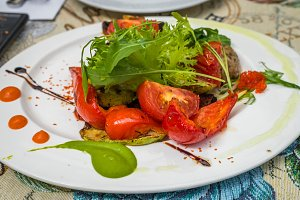 Baked tomatoes and peppers with Greens