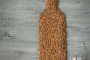 Grains and alcohol bottle