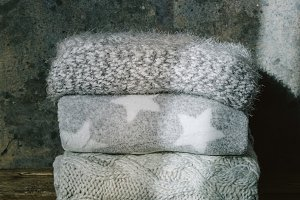 Pile of knitted winter clothes