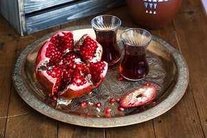 Ripe pomegranate fruit on wooden vintage table. Close view