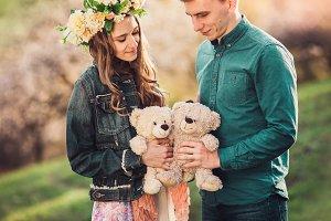 Happy girl with boyfriend and two plush teddy bear.