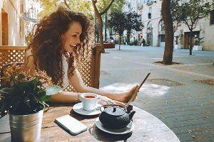 Brunette girl using her digital pad