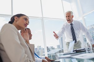 Furious boss yelling at colleagues