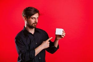 Man holding an empty cube
