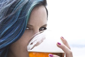Woman drinking beer