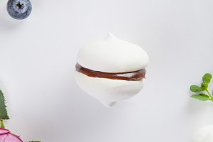 Meringue cookie with chocolate and mint on white background