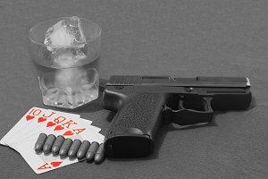 Poker royal flush, gun, bullets