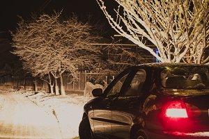 Snowy street and car light