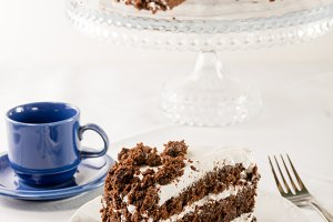 Chocolate cake with blue cup