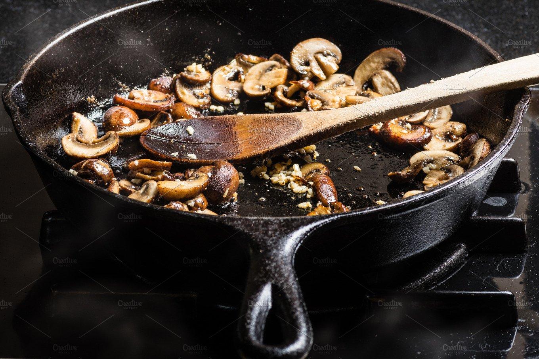 Cooking mushrooms in pan ~ Food & Drink Photos ~ Creative ...