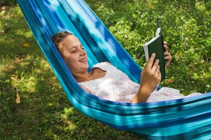 Relax with a book in the green garden